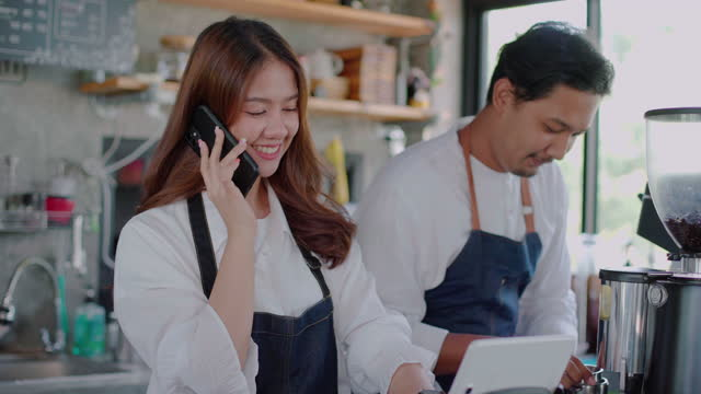 owner takes orders by phone - barista stock videos & royalty-free footage