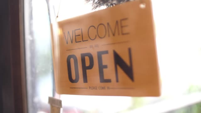 owner turning storefront sign from close to open , slow motion - bar chart stock videos & royalty-free footage