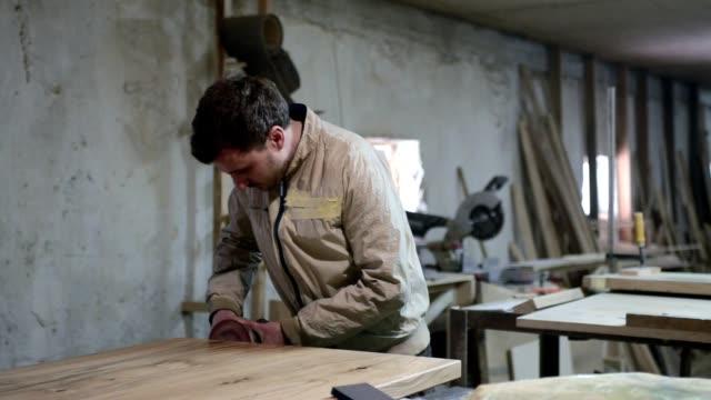 owner works in workshop. - sander stock videos & royalty-free footage