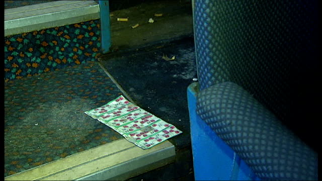 vídeos y material grabado en eventos de stock de owners of carlton cinema apply for permission to renovate lower floor of cinema discarded bingo ticket on floor next to seat debris on floor next to... - bingo