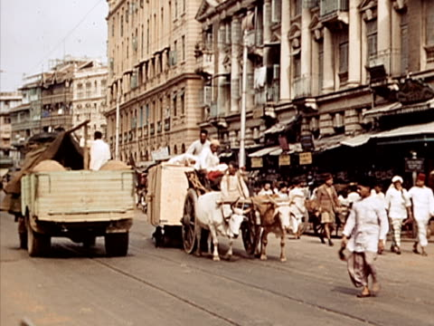 1939 ws ox pulling cart on busy road/ bombay, india  - ox cart stock videos & royalty-free footage