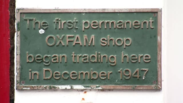First Oxfam shop ENGLAND Oxfordshire Oxford EXT Various of the first Oxfam shop to trade in 1947 / 'Rohingya Crisis Appeal poster' / plaque to...