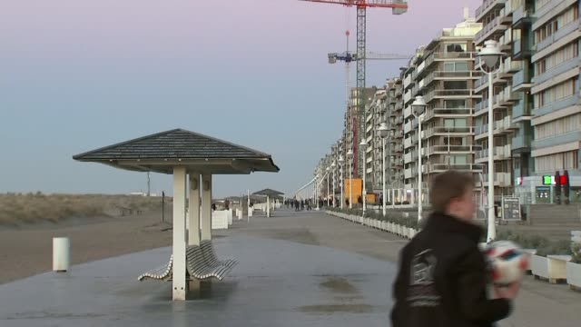 Former director denies hiring sex workers in Haiti BELGIUM Nieuwpoort EXT Promenade at seaside resort where Roland Van Hauwermeiren lives Grass along...