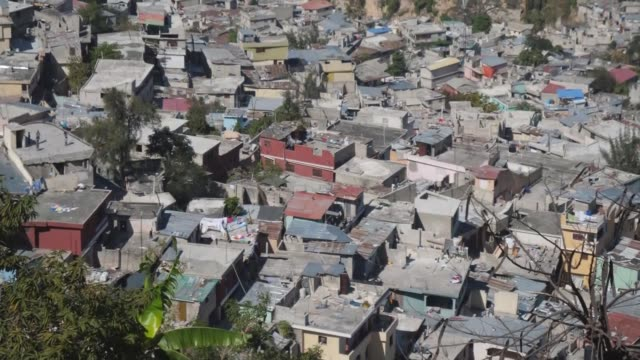 Former director denies hiring sex workers in Haiti HAITI PortauPrince EXT View over poor quality houses in city Various views over city