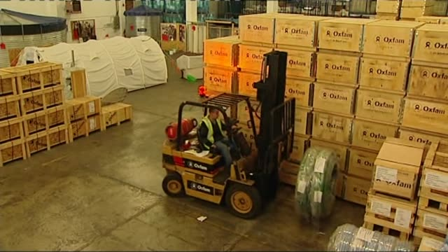 Former director denies hiring sex workers in Haiti R18011005 / Oxfordshire Bicester INT Boxes and crates in Oxfam warehouse Forklift picking up items...