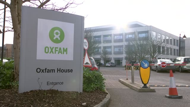Former director denies hiring sex workers in Haiti R120218001 / Oxfordshire Oxford EXT Oxfam House entrance sign with office building in background...