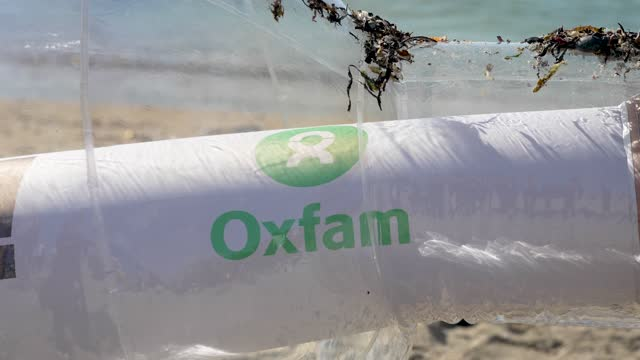 oxfam campaigners pose as g7 leaders as the charity calls on the g7 to commit to cutting emissions further and faster on june 12, 2021 in swanpool... - image effect stock videos & royalty-free footage