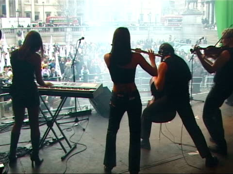 Oxfam criticises Europe over trade to developing countries ITN London Trafalgar Square Square as band playing on Oxfam fair trade campaign stage SOT...