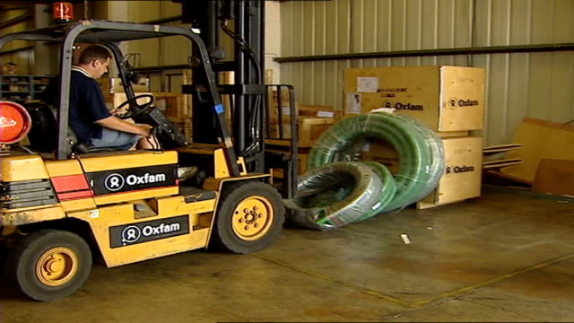oxfam sends water sanitation equipment to israel/lebanon crisis zone int/ext general views of forklift driver loading wooden aid boxes and green... - pile driver stock videos & royalty-free footage