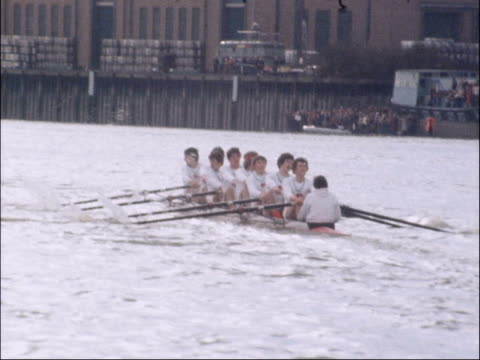 oxford and cambridge university boat race 1979 england london ext boats rowing pan boats rowing both boats approach barnes railway bridge shot... - itv late evening bulletin stock videos and b-roll footage