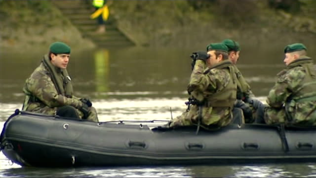 oxford and cambridge university boat race 2013; england: london: river thames: ext various of royal marines patrolling river thames in dinghy ahead... - royal marines stock videos & royalty-free footage