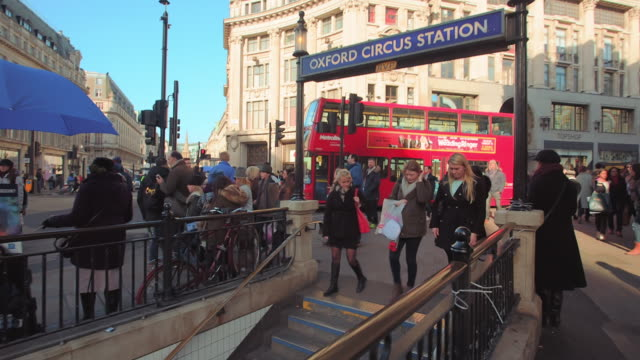 oxford circus underground station in london. - walking point of view stock videos and b-roll footage