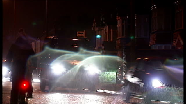 oxford grooming trial: woman weeps whilst giving evidence; oxfordshire: oxford: at night traffic along road in the rain pull focus - oxfordshire stock videos & royalty-free footage