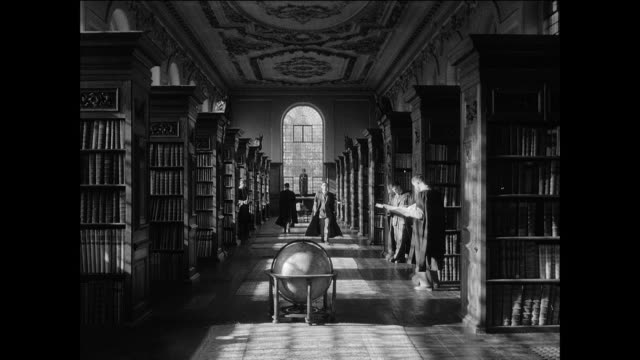 montage oxford instructor goes to the library to study / oxford, england - oxford england stock videos & royalty-free footage
