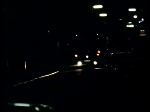 oxford street bombs; england: oxford street: debris on pavement firetender to sof: glass on pavement firemen crouch behind ladder wheel firemen... - crouching stock videos & royalty-free footage