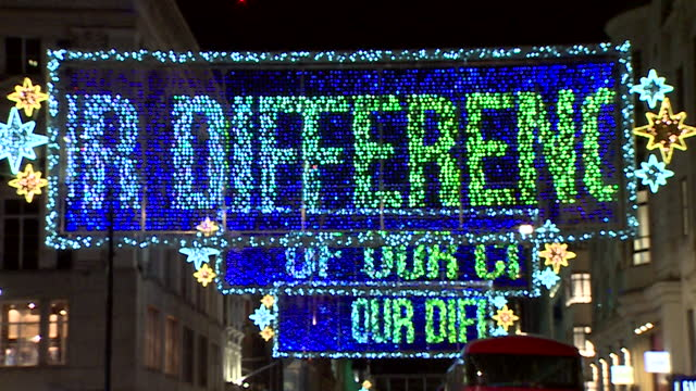 oxford street christmas lights with moving banners of text sending love to the people of london for their differences - love emotion stock videos & royalty-free footage