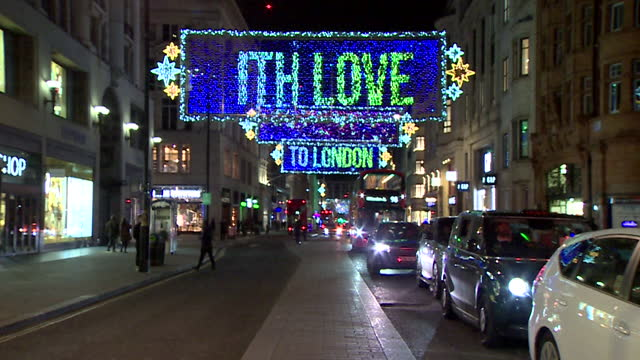 oxford street christmas lights with moving banners text sending love to london - love emotion stock videos & royalty-free footage