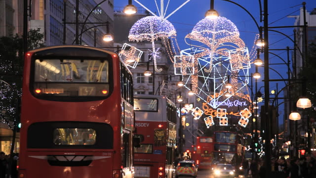 oxford street with christmas decorations in london - oxford street london stock videos and b-roll footage