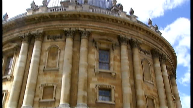 oxford university buildings and street scenes england oxfordshire oxford ext unidentified neo gothic building/ general views of the radclife camera... - oxford university stock videos & royalty-free footage