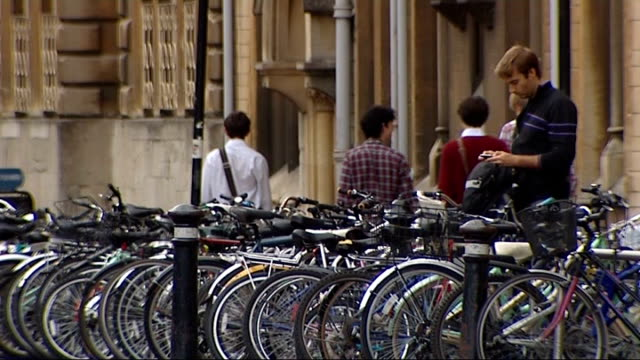 oxford university gvs and student life; statue wind vane on top of dome row of piked bicycles various gvs of students and pedestrians in oxford... - oxford university stock videos & royalty-free footage