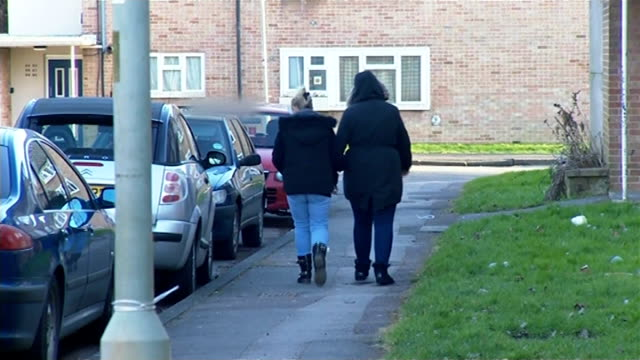 stockvideo's en b-roll-footage met oxfordshire grooming report ext anonymous shot of two teenage girls young women walking along suburban street - oxfordshire