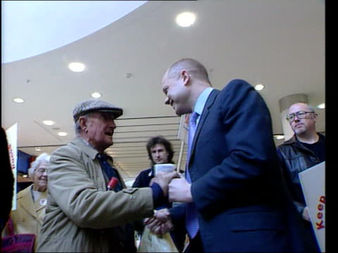 oxfordshire la ms hague towards through shopping centre with conservative party workers around as he stops to shake hands with elderly man tms legs... - hold me tight stock videos & royalty-free footage