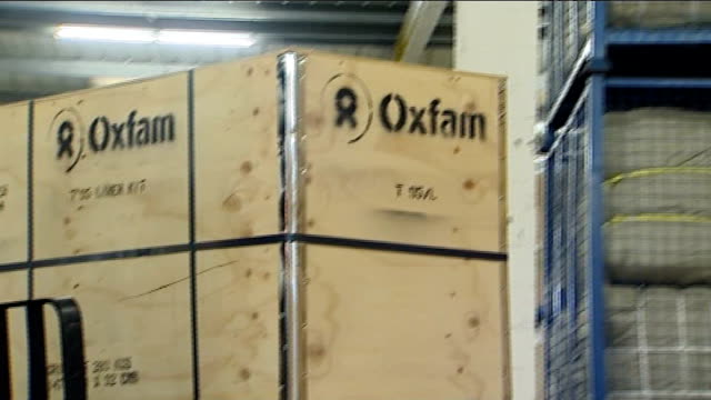 large wooden boxes of aid moved around by forklift truck in oxfam warehouse - oxfordshire stock videos & royalty-free footage