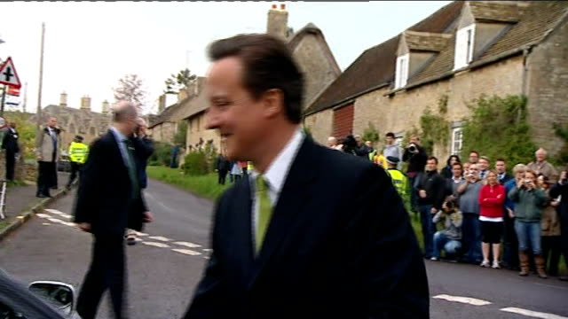witney david cameron mp along with samantha cameron to polling station samantha cameron getting into car as cameron holds door open reporter asking... - スクラム点の映像素材/bロール