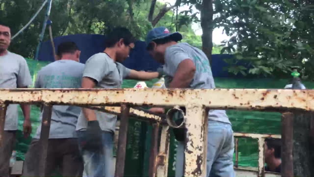 oxygen canisters being delivered to the tham luang cave in thailand where a soccer team and their coach have been trapped due to flooding from heavy... - thailand stock videos & royalty-free footage