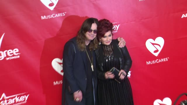 ozzy osbourne and sharon osbourne at 2014 musicares person of the year honoring carole king at los angeles convention center on in los angeles,... - シャロン オズボーン点の映像素材/bロール