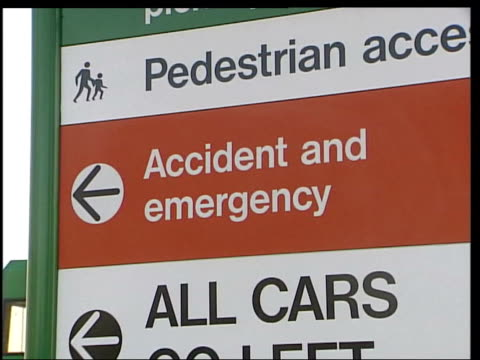 ozzy osbourne hurt in bike accident itn wexham gv accident emergency sign 'ae' sign over door bouquet of flowers with 'only one ozzy' card dr dick... - ozzy osbourne stock videos & royalty-free footage