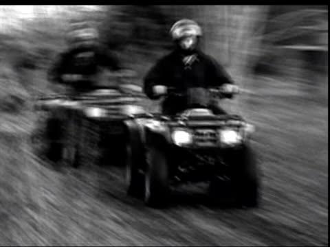 ozzy osbourne hurt in bike accident lnn = no resale b/w blurred pix riders along on quad bikes - ozzy osbourne stock videos & royalty-free footage