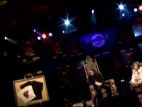 ozzy osbourne on another band at ozzfest he likes system of a down at the unveiling of signature series tshirt with ozzy and sharon osbourne at hard... - hard rock cafe stock videos & royalty-free footage