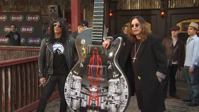 Ozzy Osbourne Signs a 10Foot Guitar at The House Of Blues Hollywood CA United States 01/10/11