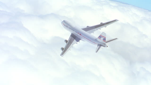 "a 747 'pac atlantic"" airplane banks above the clouds. - 1994 stock-videos und b-roll-filmmaterial"