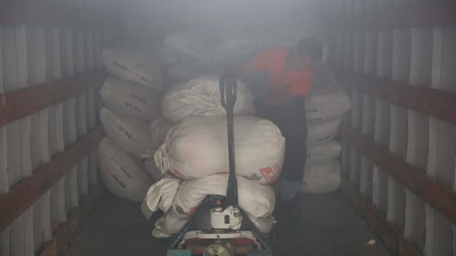 pacas huge bundles of used clothing imported from the united states at the main sorting facility for megapaca in amatitlan guatemala tuesday may 24... - entladen stock-videos und b-roll-filmmaterial