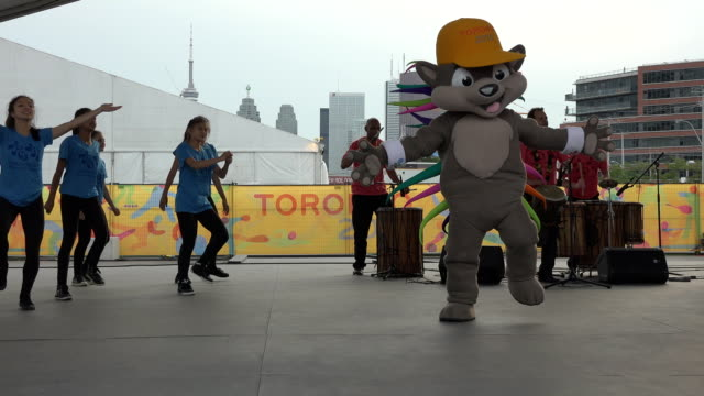 stockvideo's en b-roll-footage met pachi the mascotte of the toronto panam games the country representation is welcome in the athletes' village the pan american games are the largest... - redactioneel
