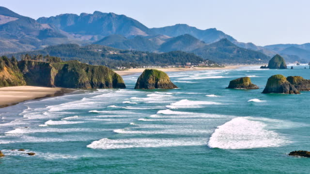pacific coast at cannon beach - cannon beach stock videos & royalty-free footage