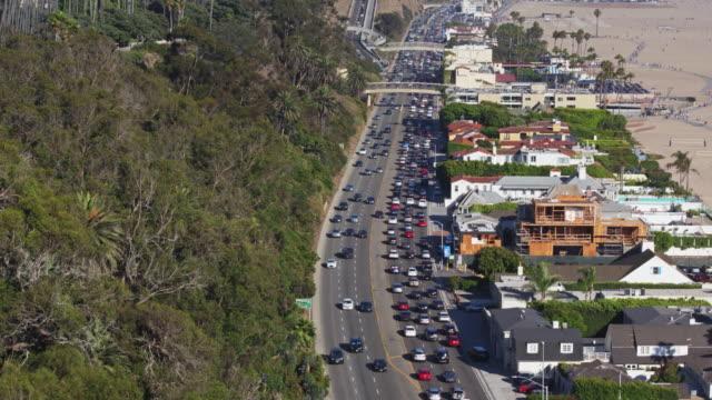 pacific coast highway traffic through santa monica - drone shot - palisades park stock videos & royalty-free footage