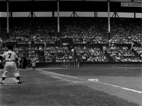 pacific coast league baseball game between the hollywood stars and their rivals los angeles angels , spectator stands in bg, gilmore field /... - pacific war stock-videos und b-roll-filmmaterial