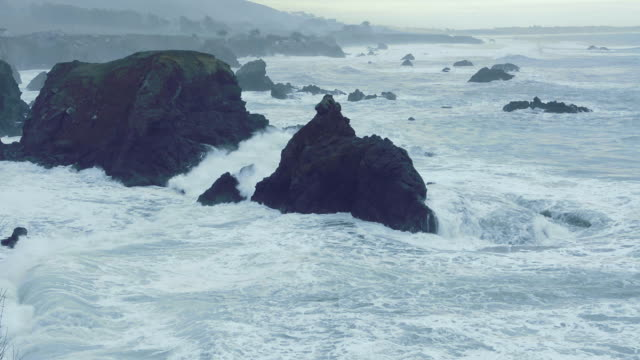 stockvideo's en b-roll-footage met pacific coasy highway route 1 california near jenner duncan's covewith waves and rocks from highway with ocean at sunset ca - ruw