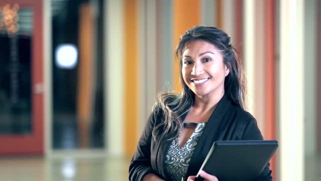 Pacific Islander businesswoman smiling at camera