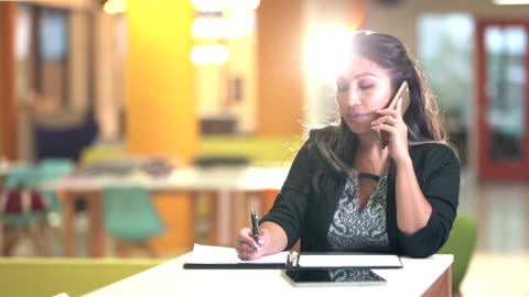 pacific islander businesswoman talking on phone, writing - pacific islander stock videos & royalty-free footage
