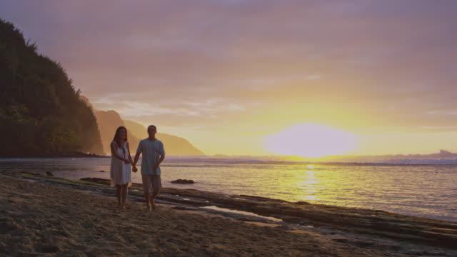 pacific islander couple walking up beach - pacific islander stock videos & royalty-free footage