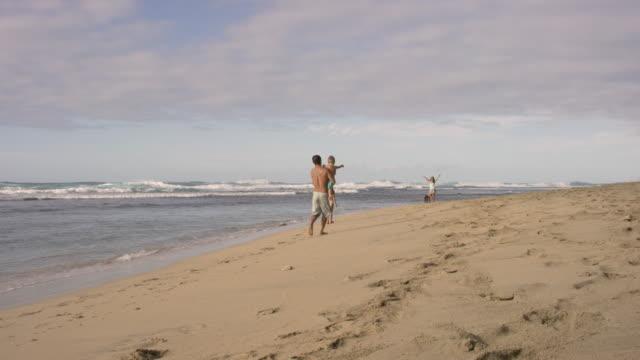 pacific islander family walking down a beach - pacific islander stock videos & royalty-free footage