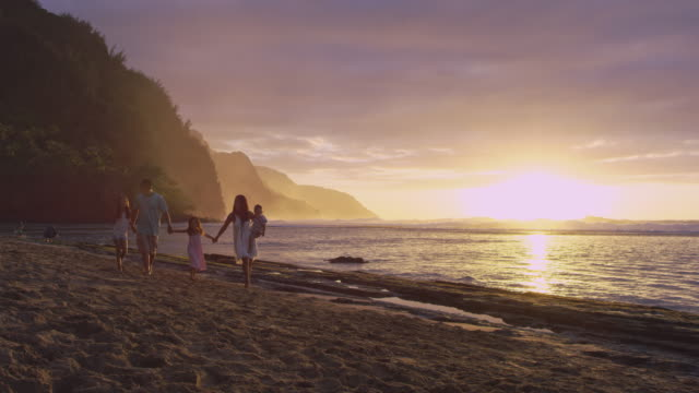 pacific islander family walking up beach during sunset - pacific islander stock videos & royalty-free footage