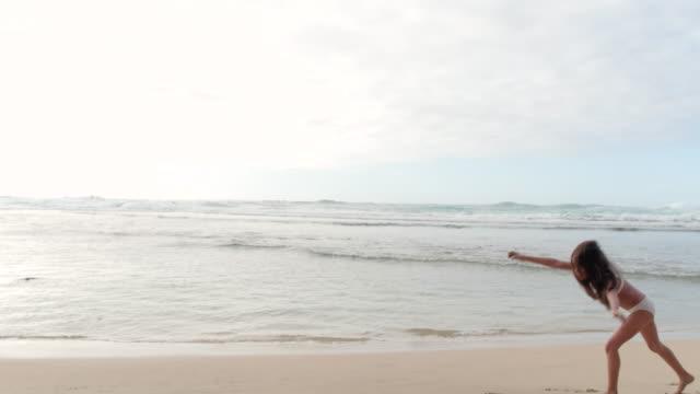 pacific islander girl doing cartwheels along beach - pacific islander stock videos & royalty-free footage