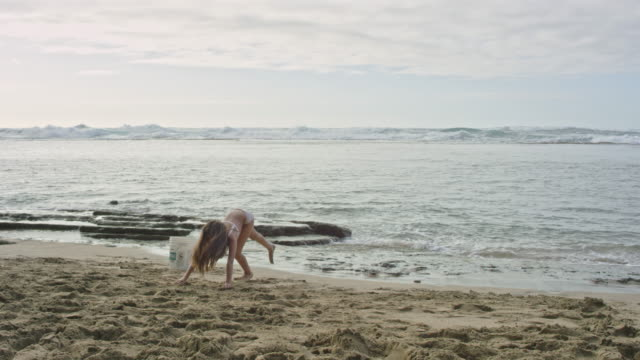 pacific islander girl doing hand stand on beach - pacific islander stock videos & royalty-free footage