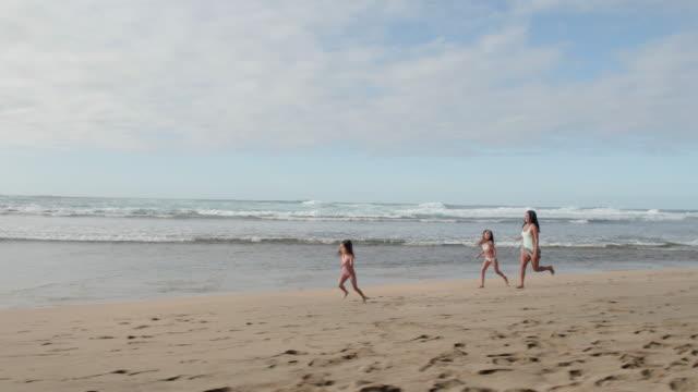 pacific islander girl running along the beach - pacific islander stock videos & royalty-free footage
