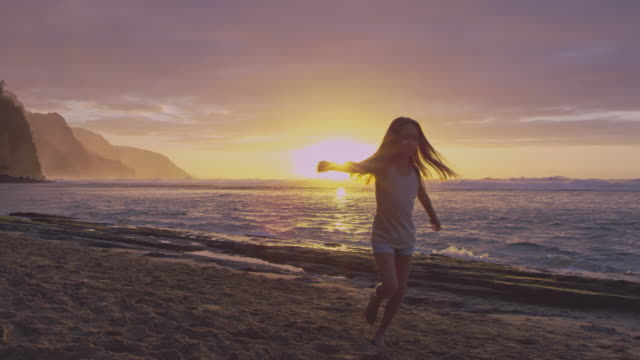 pacific islander girl spinning in circles on a beach - pacific islander stock videos & royalty-free footage
